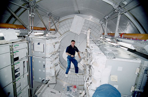 Cosmonaut Yuri Gidzenko floats inside Leonardo, the first MPLM to deliver supplies to the Station. Credit: NASA