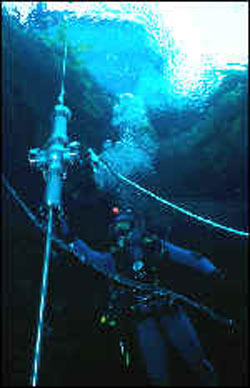 Diver deploying the probe