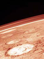 Mars from a Viking orbiter. The hazy, red lines near the edge of Mars result from dust suspended in the martian atmosphere. Credit: NASA/JPL/Malin Space Science Systems