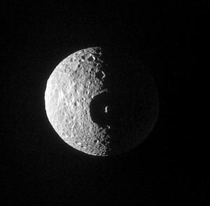 Mimas from Cassini on Jan. 16, 2005, showing crater Herschel
