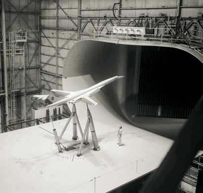 A model of a supersonic transport is tested in a wind tunnel at NASA's Langley Research Center in July 1973. Credit: NASA