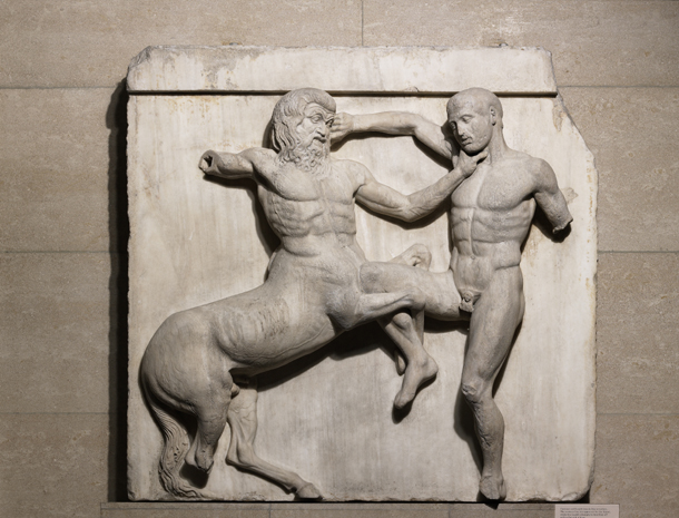 Stone carving from the Parthenon in Athens showing a centaur (left) fighting a lapith (a legendary human)