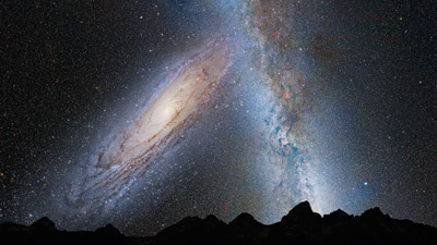An illustration shows the night sky 3.75 billion years from now. Andromeda (left) fills the field of view and begins to distort the plane of our Milky Way Galaxy