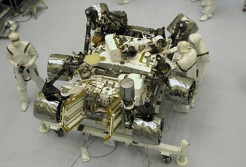 The Curiosity rover under going final preparations and being checked out by technicians