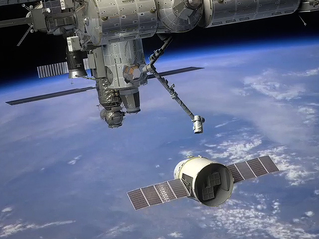 Dragon preparing to dock at the International Space Station
