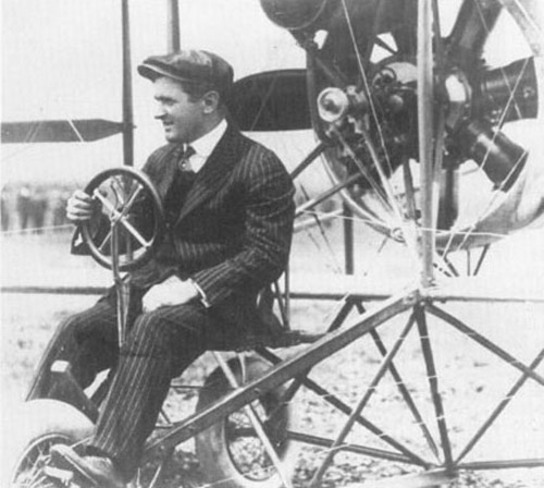 Lincoln Beachey in his plane wearing a business suit