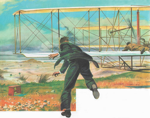 The first flight by a powered airplane at Kitty Hawk. Orville Wright is at the controls while Wilbur, on the ground, tries to hold one wing to prevent the aircraft wobbling